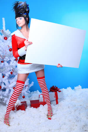 Beautiful young woman in Santa Claus clothes over Christmas background. Stock Photo - 8318825