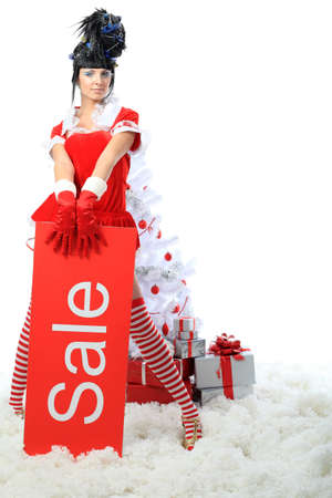 christmas stockings: Beautiful young woman in Santa Claus clothes over Christmas background.