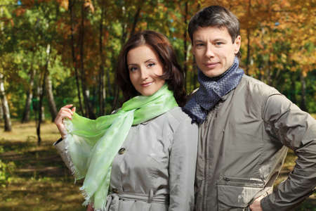 Happy married couple at the autumn park. Stock Photo - 8318868