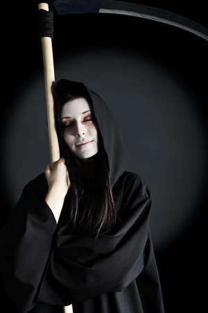 Woman death reaper over black background. Halloween. Stock Photo - 8318890