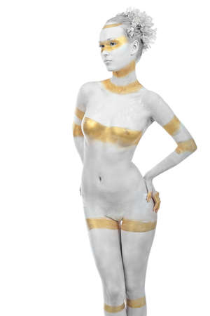 Artistic woman painted with  white and bronze colors, over white background. Body painting project.  Stock Photo - 8318885
