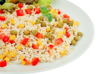 A plate with steamed long rice with green peas, corn and pepper. Isolated over white background. Stock Photo - 8373803