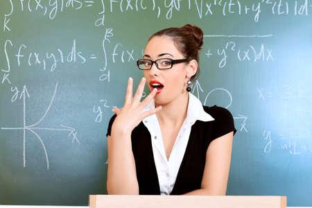 Educational theme: portrait of a teacher giving a lecture. photo