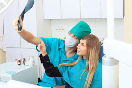 Shot of a young woman with dentists in a dental surgery. Healthcare, medicine. Stock Photo - 8385617