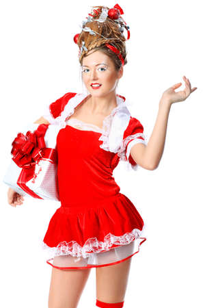 Beautiful young woman in Santa Claus clothes, isolated over white background. Stock Photo - 8389678