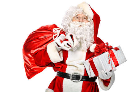 Christmas theme: Santa Claus with presents. Isolated over white background. photo