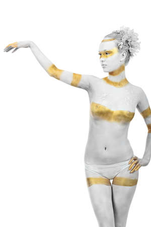 Artistic woman painted with  white and bronze colors, over white background. Body painting project.  photo