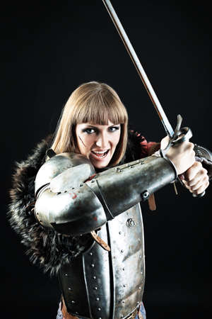knights: Portrait of a medieval female knight in armour over black background.