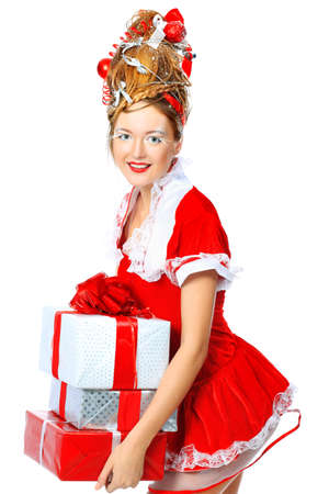 Beautiful young woman in Santa Claus clothes, isolated over white background. photo