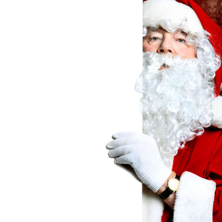 Portrait of Santa Claus holding white board. Christmas.