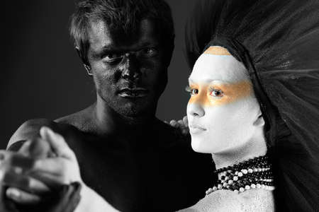 black moor: Passionate couple with bodies painted in white and black colors. Body painting project.  Stock Photo