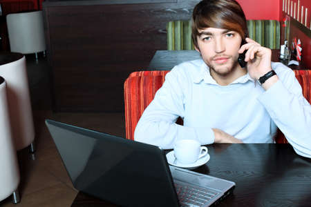 Young business man having a break at a caf Stock Photo - 8444979