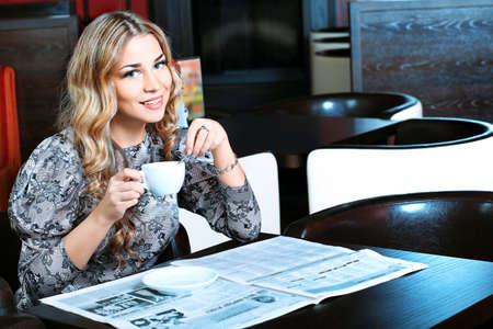 having a break: Young woman having a break at a caf