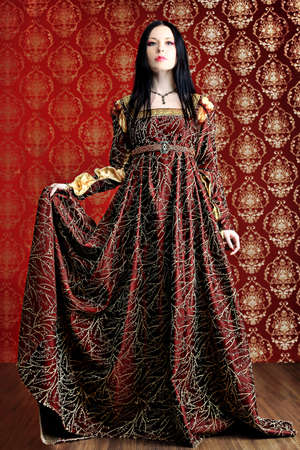 medieval dress: Portrait of a beautiful woman in medieval era dress. Shot in a studio. Stock Photo