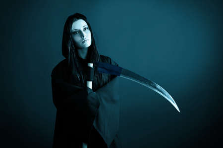 Woman death reaper over black background. Halloween. Stock Photo - 8478341