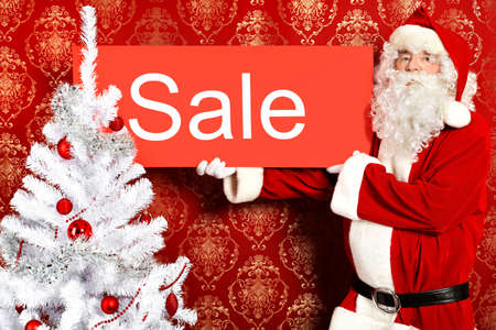 Santa Claus with presents and New Year tree at home. Christmas sale. Stock Photo - 8478372