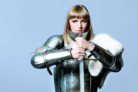 Portrait of a medieval female knight in armour over grey background. Stock Photo - 8492930