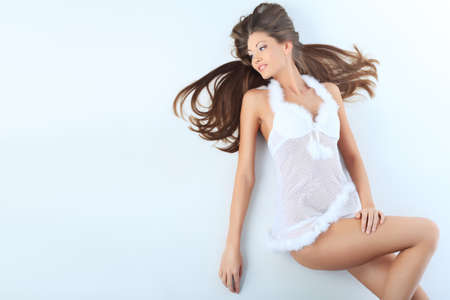 Shot of an attractive young woman in white lingerie. Isplated over white background. Stock Photo - 8492926
