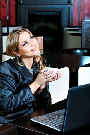 Young business woman having a break at a caf photo