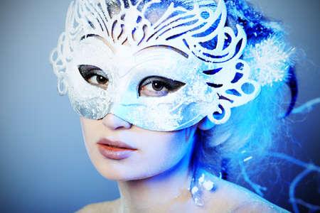 Art portrait of a beautiful female model in a carnival mask.  Fashion, beauty. photo