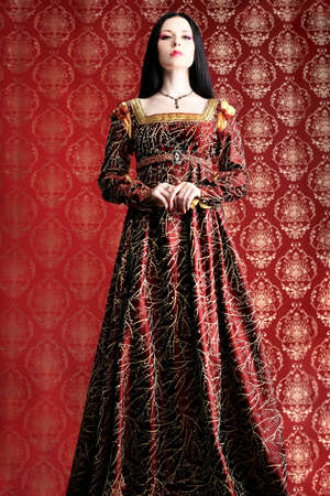 queens theatre: Portrait of a beautiful woman in medieval era dress. Shot in a studio. Stock Photo