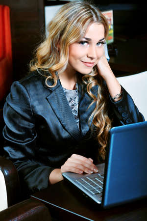 having a break: Young business woman having a break at a cafe. Stock Photo