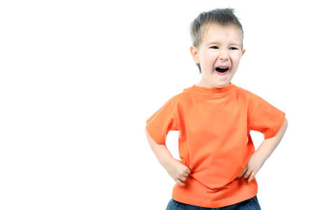 Portrait of a funny little boy making faces. Isolated over white background. photo