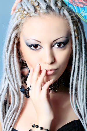 Portrait of a stylish young woman with white dreadlocks. Fashion. Stock Photo - 8587225