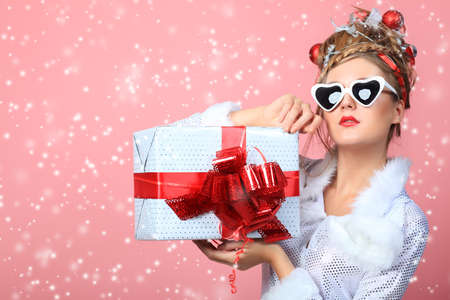 Beautiful young woman in Christmas clothes over pink background. Stock Photo - 8587120
