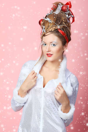 Beautiful young woman in Christmas clothes over pink background. Stock Photo - 8587130