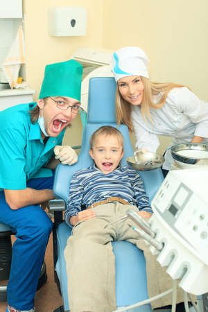 Shot of a little boy with dentists in a dental surgery. Healthcare, medicine. Stock Photo - 8587224
