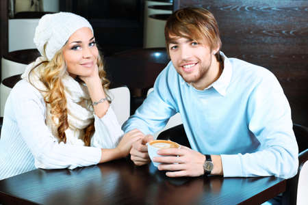 caf: Happy couple of young people having a date at a caf Stock Photo