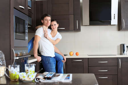 family kitchen: Happy married couple having a rest at home.