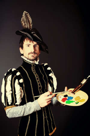 century: Portrait of a handsome man artist in 16th century costume. Shot in a studio. Stock Photo