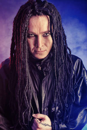 Portrait of a heavy metal musician. Shot in a studio. Stock Photo - 8646641