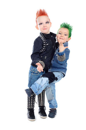 Shot of two little boys posing in costumes of rock musicians. Isolated over white background. photo