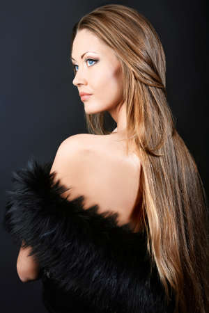 Fashion photo, beautiful model is posing over black background Stock Photo - 8646679