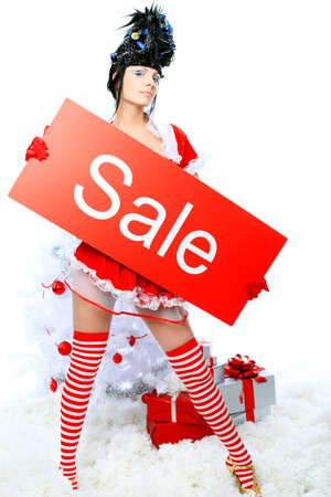Beautiful young woman in Santa Claus clothes over Christmas background. Stock Photo - 8646678