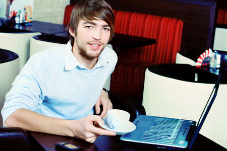 caf: Young business man having a break at a caf