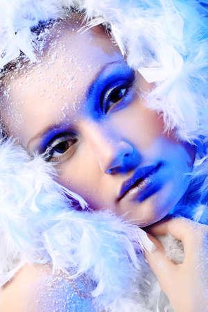boa: Art portrait of a snow female model in fur.  Fashion, beauty.