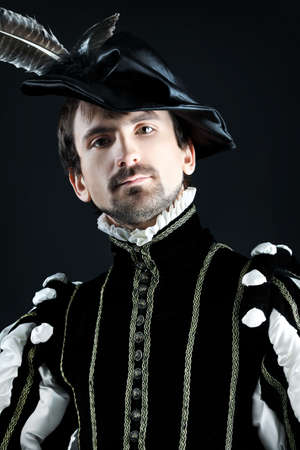 16th century: Portrait of a handsome man grandee in 16th century costume. Shot in a studio. Stock Photo