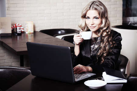 Young business woman having a break at a café. Stock Photo