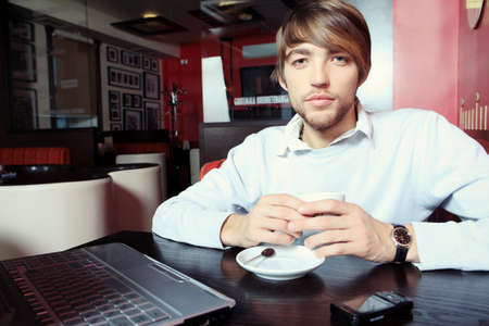 Young business man having a break at a caf photo