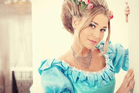 Portrait of a beautiful woman in medieval era dress. photo