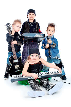 Group of children singing in heavy metal style. Shot in a studio. Isolated over white background. Stock Photo - 8835029
