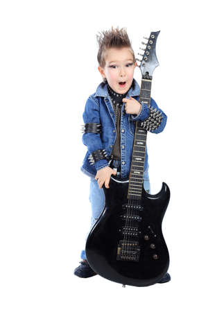 Shot of a little boy playing rock music with electric guitar. Isolated over white background. Stock Photo - 8834983