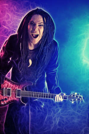 Heavy metal musician  is playing electrical guitar. Shot in a studio. Stock Photo - 8834992