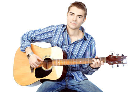 man playing guitar: Handsome young man musician playing his guitar. Isolated over white background.