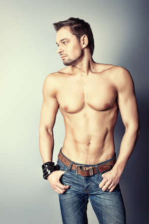 Portrait of a handsome muscular young man. Shot in a studio. Stock Photo - 8835027