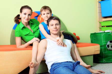 Happy parents with their son at home. photo